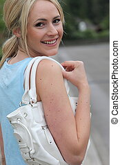 Pretty woman with a handbag over her shoulder