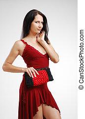 Pretty woman with a handbag.