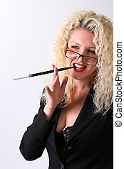 Pretty woman with a mouthpiece. Curly blonde on the grey