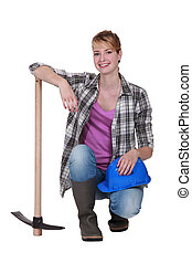 Pretty woman with a pickaxe