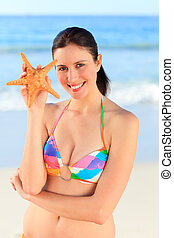 Pretty woman with a starfish