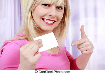 Pretty woman with business card