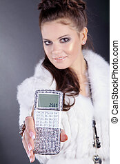pretty woman with calculator