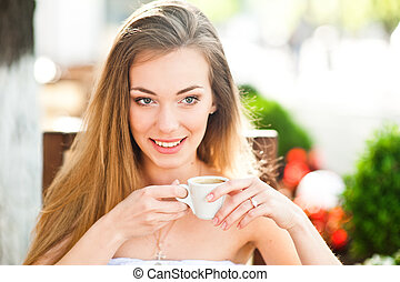 Pretty woman with cup of coffee