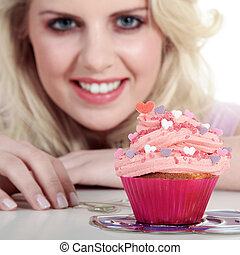 pretty woman with cupcake