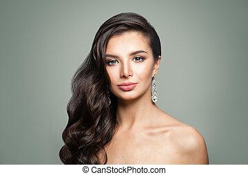 Pretty woman with diamonds earrings