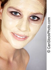 pretty woman with facial mask