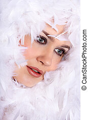 pretty woman with feathers