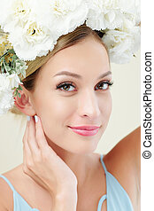 Pretty woman with floral wreath