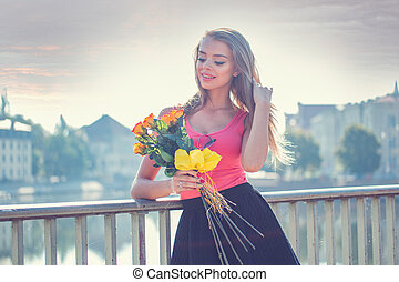 Pretty Woman with Flowers Leaning Against Rail