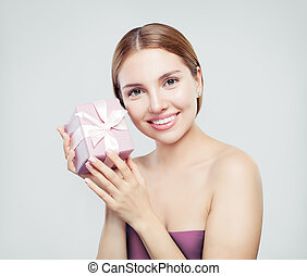Pretty woman with gift on white background