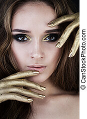 Pretty Woman with Golden Makeup