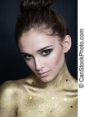 Pretty Woman with Golden Skin and Smokey Eyes Makeup