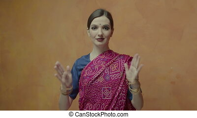 Pretty woman with hands joined in namaste greeting