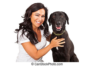 pretty woman with happy dog a beautiful adult woman holding onto a happy labrador retriever dog with picture csp21991014
