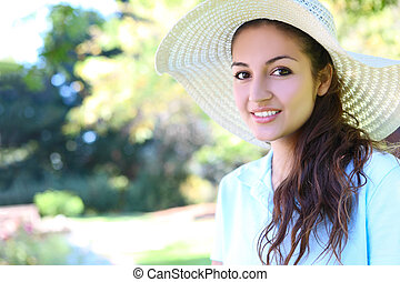 Pretty Woman with Hat in Park