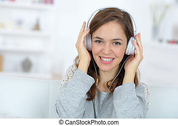 pretty woman with headphones smiling