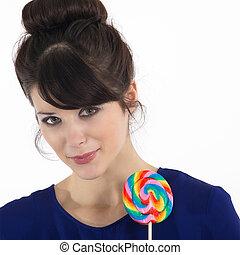 pretty woman with lollipop
