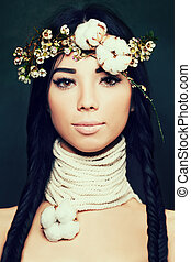 Pretty Woman with Long Black Hair and Flowers Crown. Ethnic Beauty
