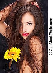 long hair and yellow daisy