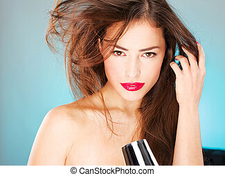 woman with long hair holding blow dryer - pretty woman with...