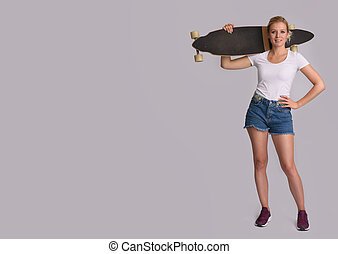 pretty woman with longboard posing in studio isolated on...