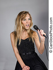 Pretty woman with microphone singing