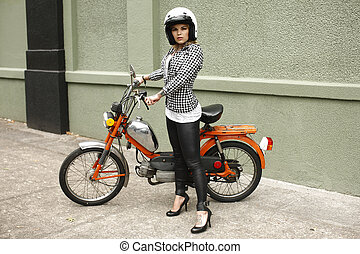 Pretty woman with moped
