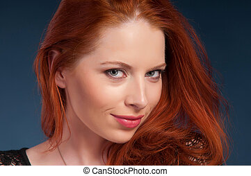 pretty woman with red hair, blue background