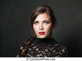 Pretty woman with red lips makeup hair on black background