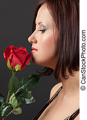 Pretty woman with rose.