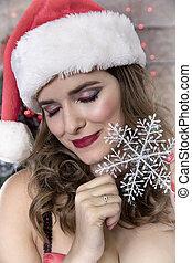 Pretty woman with snowflake