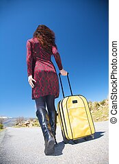 pretty woman with suitcase