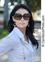 Pretty woman with sun glasses on.