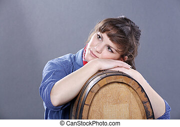 pretty woman with wine barrel