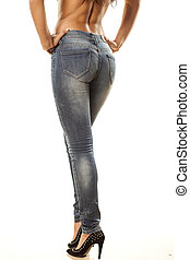 pretty woman's legs and buttocks in tight jeans