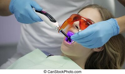 Pretty woman's teeth treatment in dental clinic - Courageous...