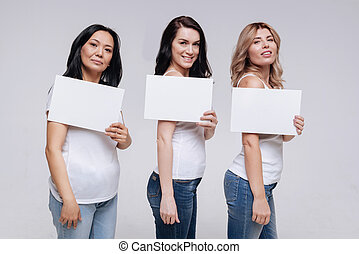 Pretty women of different backgrounds posing together
