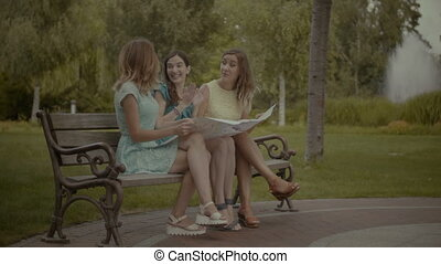 Pretty women searching direction on location map