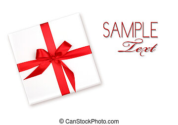 Pretty Wrapped Holiday Gift With Red Ribbon and Bow