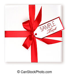 Pretty Wrapped Holiday Gift With Red Ribbon and Gift Tag