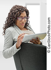 african american woman with eyeglasses and tablet computer