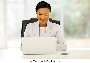young african business executive using laptop