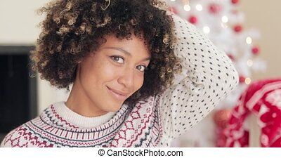 Pretty young African woman with an afro hairstyle