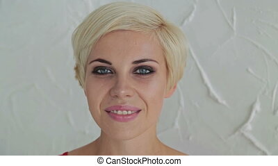 Pretty, young and sensual woman with beautiful make-up and short hairstyle