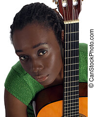 Pretty young black woman holding accustical guitar