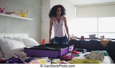Pretty Young Black Woman Packing Bags For Holidays - Excited...