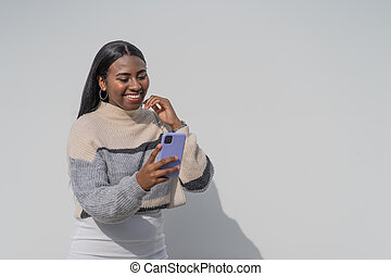 Young black woman with a purple smartphone