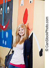 Pretty young blond girl at school