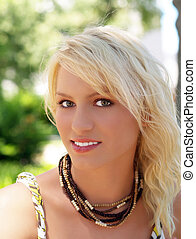 Pretty young blond teen girl outdoor portrait